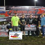 Frank Heckenast Jr. is joined by his crew after winning the 30 lap, Late Model feature.