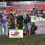 14 year old Mikey Ledford is joined by his family after winning his first career Sportsman division.