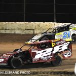 Frank Marshall in the 28 leads Derek Losh in the 21 during the UMP Modified feature Saturday. Losh would go on to get ahead of Marshall and win the 25 lap feature at Plymouth Speedway.
