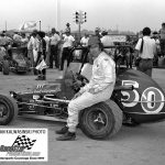"""Before qualifying began in 1978 for the """"Hut 100"""" at the """"Action Track"""" in Terre Haute, Ind., Roger West poses by his ride for the day – the Bud Doty No. 50 midget. (Stan Kalwasinski Photo)"""