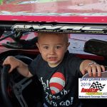 """This is 2 year old Eli from North Judson.  Eli's favorite driver is Mitch Bailey.  Here he's showing Mitch that he could drive with one hand while posing for a photo.  Eli is RaceStar's """"Little RaceFan of the Night!"""""""