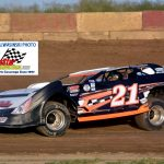 Veteran Chicago area stock car racer Bobby Gash (21) captured his first career feature race on dirt last Saturday night at Indiana's Shadyhill Speedway, winning the UMP Pro Late Models main event.