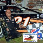 Bobby Gash poses in victory circle.