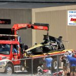 James Hinchcliffe's badly damaged car is brought into Gasoline Alley.