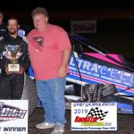 Track promoter Jerry Gappens presented sprint car feature winner Thomas Meseraull the Jerry Gappens Sr. Memorial trophy in victory lane.
