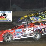 Bobby Pierce (32) and Billy Moyer (21) battle for position during the 40-lap Summer Nationals main event