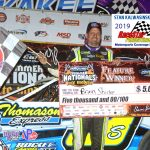 Brian Shirley poses on the victory podium after winning the opening night DIRTcar UMP Summer Nationals 40-lap main event at Illinois' Kankakee County Speedway Thursday night.