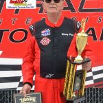 Woody Pool poses with his trophies after winning the Upper Midwest Vintage Series race at Milwaukee.
