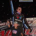 Brandon Sheppard, along with his son, celebrate his Prairie Dirt Classic win