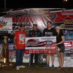 Brandon Sheppard, receives a check for $30,000 from representatives for the Bank of Pontiac, in winning his second Prairie Dirt Classic.