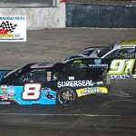 Matt Kenseth (#8) squeezes inside of Ty Majeski (#91 with Kenseth racing to the checkered flag and the victory in the 40th annual SUPERSEAL Slinger Nationals presented by Miller Lite