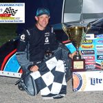 Former NASCAR 'Cup winner and champion, Matt Kenseth poses in victory circle after he won the 40th annual SUPERSEAL Slinger Nationals presented by Miller Lite super late model stock car special at Wisconsin's Slinger Speedway Tuesday night.  Returning to competition in his homestate, Kenseth captured the race for the eighth time in his career.