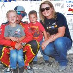 Fast qualifier Steve Apel and his family pose during pre-race ceremonies.  Apel and his wife, Liz, and sons, Cameron (left) and Harrison are in the family photo.