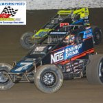 Tyler Courtney (#7) and Chase Stockon (#32) battle during the 30-lap feature.