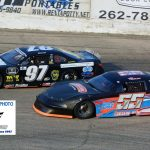 With the laps winding down, Tyler Schley (#55) and Jacob Nottestad (#97) battle for the lead and the win during the limited late model headliner.