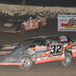 Tommy Duncan 32 is challenged by Steve Mattingly 7 early in the 15 lap feature