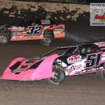 Amber Crouch 51A races for the lead with track champion, Tommy Duncan 32