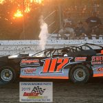 During super late model heat race action, Adrian Roscelli finds his No. 117 a little too hot!