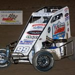 Ryan Probst (#99) scored a heat race during the Badger midget action.
