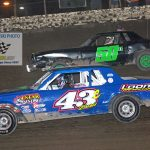 Stacy Doris (#43) races with John Dietrich III (#50) during the Pure Stocks feature.