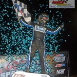 Thomas Meseraull celebrates after winning the 30-lap USAC AMSOIL National Sprint Car feature race which opened Indiana's Kokomo Speedway's Sprint Car Smackdown VIII Thursday night.