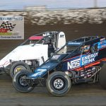 Tyler Courtney(#7) and Scott Weir (#4) go at it during heat race action.