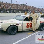 """Rich Oertel stands next to his Ford Torino No. 59 prior to one of his last USAC stock car appearances at the """"Milwaukee Mile"""" in 1972.  (Stan Kalwasinski Photo)"""
