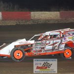 Beau DeYoung (#27) led the early laps of the modified headliner.
