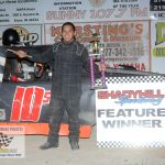 Brandon Shelhart poses in victory lane after winning the $500 4-Bangers division 50 lapper.