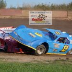 As Dan Richardson (#8) rode over the front of Hammond's new ride during a late model heat race skirmish.