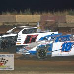 Lane Jackson (#10) and Cameron Shidler (#11) race wheel-to-wheel during the I-Mod main event.