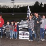 Clayton Bryant and crew in victory lane after winning the modified feature Sunday.