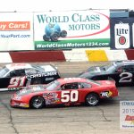 Jake Gille (#50) tries the bottom groove with Ty Majeski (#91) and Michael Bilderback (#2) working the high line.