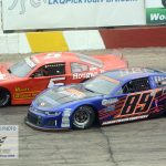 Brad Mueller (#89), who finished second, battles with eventual winner Casey Johnson.