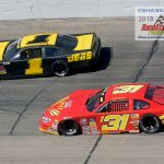 Cody Coughlin (#1) goes around Kyle Crump (#131).