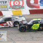 Showing some racing scars, Josh Nelms (#0) and Rich Bickle Jr. (#45) continue to battle.
