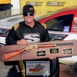 Florida racer Stephen Nasse shows off his new Winchester rifle trophy after he won the 48th annual Winchester 400 presented by CB Fabricating ARCA/CRA Super Series late model stock car special at Indiana's Winchester Speedway Sunday afternoon.