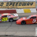 Leader Steve Apel (#51) is chased by eventual winner Casey Johnson (#5) during the National Short Track Championships late model stock car special.