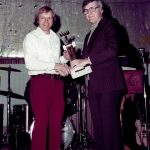 During a late 1970s year-end banquet, Bill Davis receives his trophy from Kankakee promoter Wayne Etzel.  (Bill Davis Collection)
