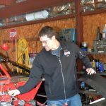 Jeff Curl doing a little tune up on his race car.