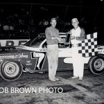 On his way to winning his first O'Hare Stadium championship in 1962, Erik Johnson receives a trophy from starter Art Kelly.  (Bob Brown Photo)