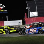 Michael Bilderback (#2) feels the pressure from Ricky Baker (#52) and Rich Bickle Jr. after an early-race restart.