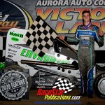 Chase McDermand poses in victory lane after winning the 25-lap Badger Midget Series main event.