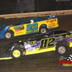 Glen Toppel (#82) and Danny Deutsch (#23) battle for position during the super late model main.