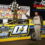 Greg Cantrell Jr. poses in victory lane after winning the 50-lap feature race for super late models at Illinois' Sycamore Speedway Saturday night.