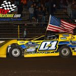 Greg Cantrell Jr. carries the American Flag during the evening's opening ceremonies.