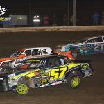 Three-wide street stocks action sees Joel Hernandez (#57), Tim Loomis (#93) and Eric Newhouse (#21) looking to better their position.