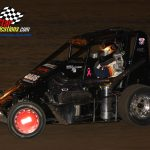 Kevin Olson (#9) is a veteran of many midget racing battles.