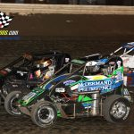 Will Armitage (#40A), Kevin Olson (#9) and Derek Doerr (#20) battle during the midget feature.