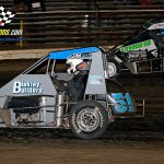 Zach Boden (#51) works the bottom groove in an attempt to take the lead from Chase McDermand (#40) during the 25-lap Badger Midget Series headliner.